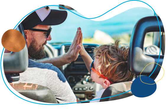dad and son high five in car