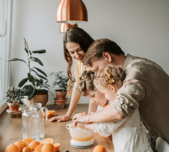 Family Hand Pressing Orange Juice Together