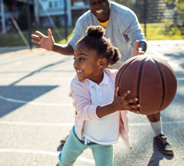 grandfather-and-granddaughter-playing-basketball