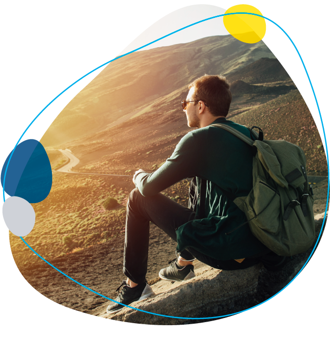 man with backpack overlooking a mountin