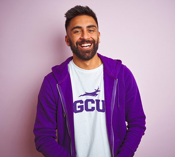 Man in  Purple Hoodie and GCU Shirt Smiling