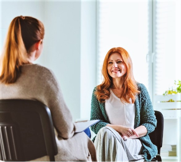 smiling-woman-with-a-counselor