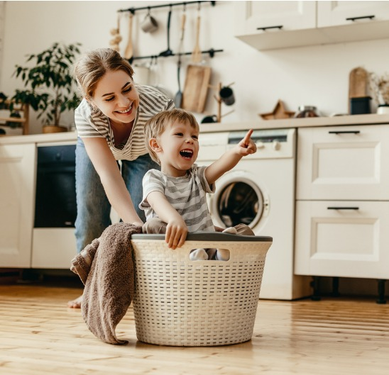 Mother and Son Playing in Laundry Basket