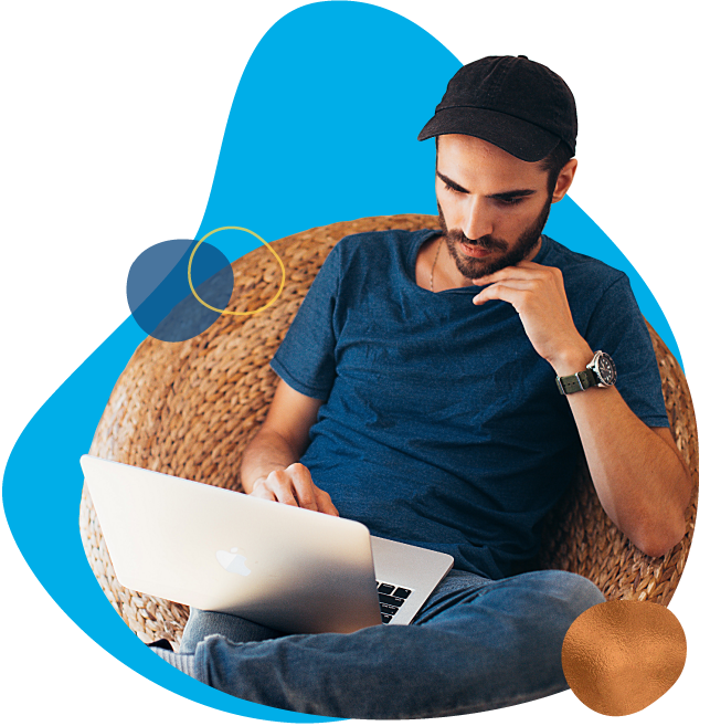 man on laptop in chair