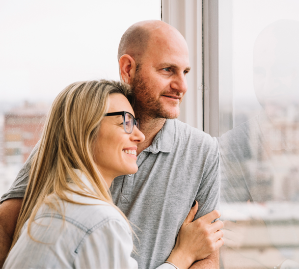 couple smiling looking outside window
