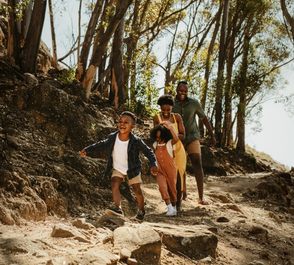 family-running-down-rocky-trail