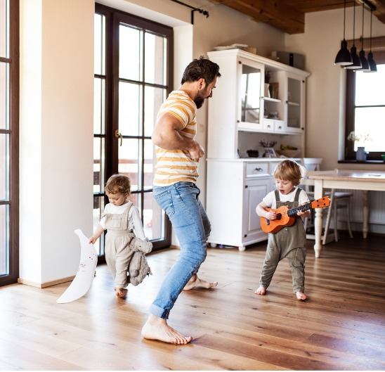 Family playing in newly purchased home