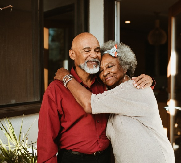 smiling-elderly-woman-embracing-husband