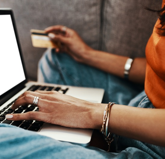 Woman using her card and computer
