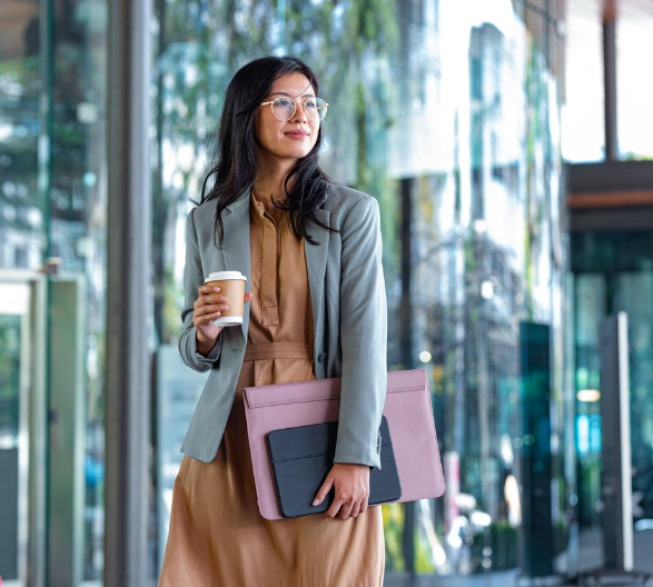 happy-successful-asian-businesswoman-holding-a-takeaway-coffee-cup-picture-id1215174668