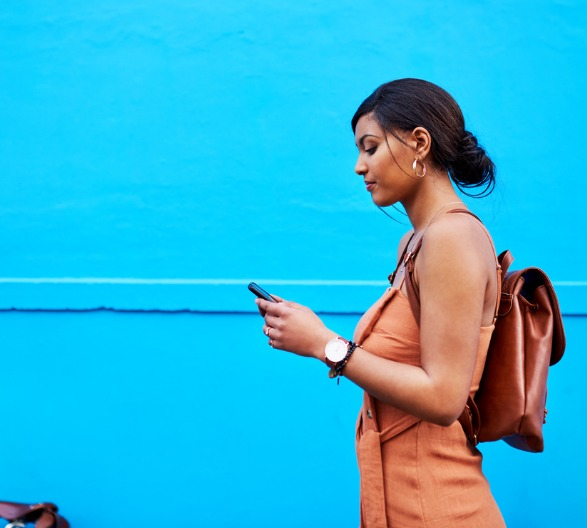 Woman walking with phone in hand