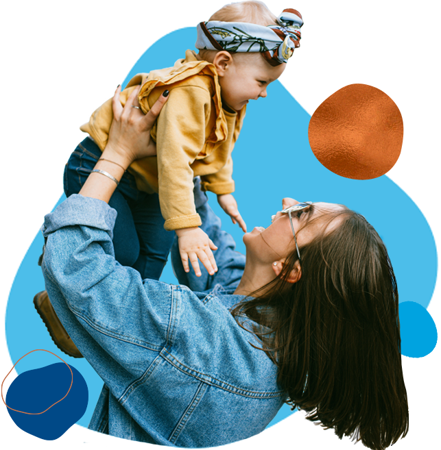 woman holding child up in the air