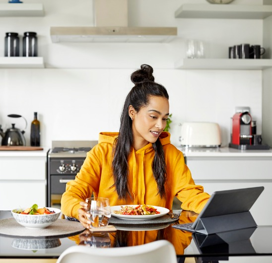 woman-using-digital-tablet-while-having-breakfast