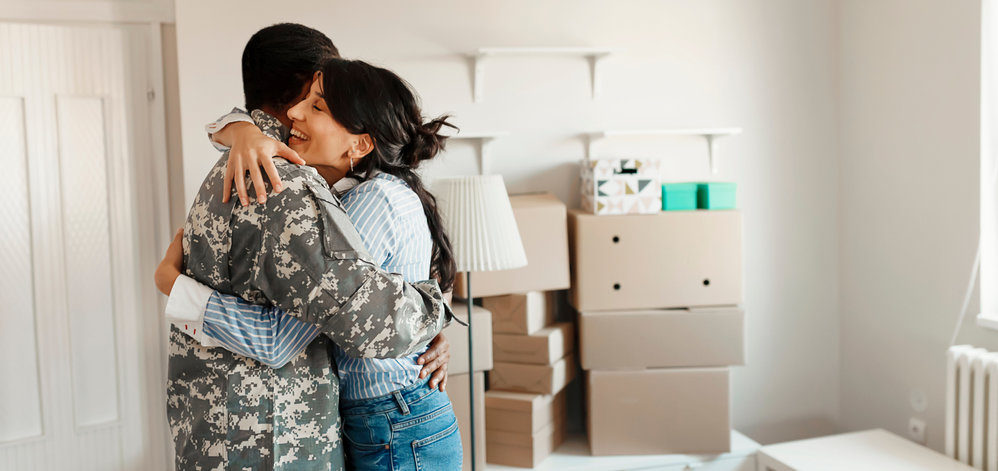 wife-embraces-veteran-husband-while-moving-into-new-home