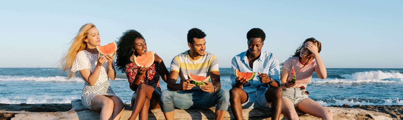 friends-on-beach-eating-watermelon